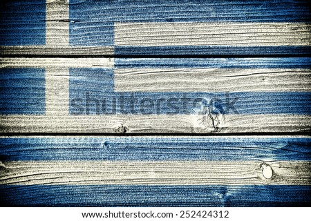 flag of Greece painted on old grungy wooden  background