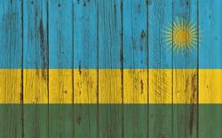 Flag of Rwanda painted on wooden frame