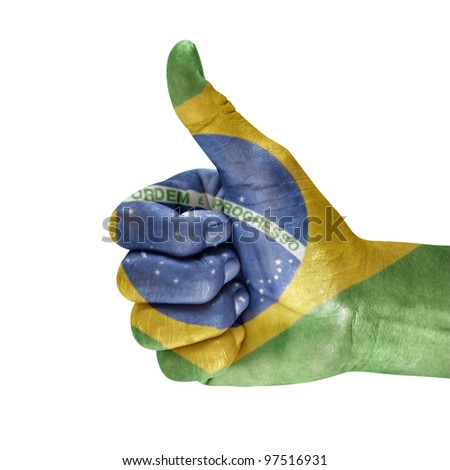 Flag of the brazil on men hand with a white background.