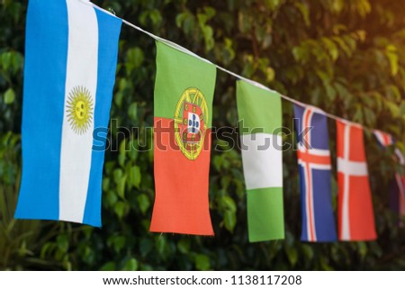 flags outdoor against green tree #1138117208