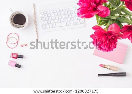 Flat lay home office workspace with keyboard, notepad and flowers on white table. Woman background #1288827175
