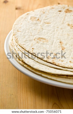 flour tortillas on wooden table