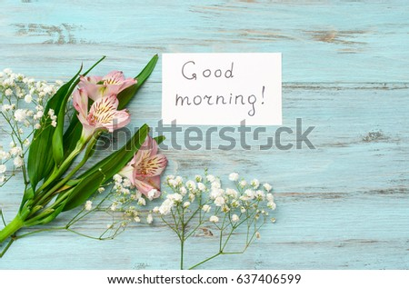 """Flowers and the inscription """"Good Morning"""" on a wooden, turquoise background. The concept of happiness and joy. #637406599"""