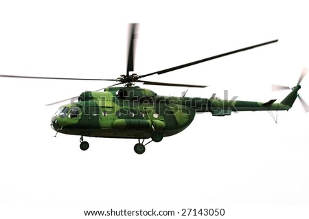 Flying military  helicopter isolated on white