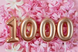 1000 followers card. Template for social networks, blogs. Background with pink flowers. Social media celebration banner. 1k online community fans. 1 one thousand subscriber
