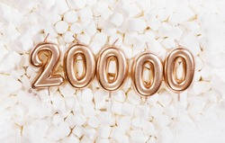 20000 followers card. Template for social networks, blogs. Background with white marshmallows. Social media celebration banner. 20k online community fans. 20 twenty thousand subscriber