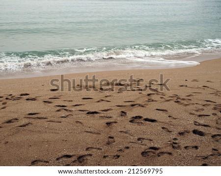 footprint on the beach in Thailand