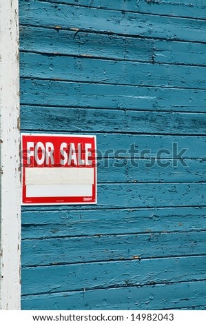 """""""For Sale"""" sign on old wooden home in Nevada"""