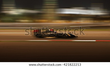Formula 2.0 race car racing at high speed with motion blur on the background of the city in the dark