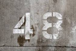 48 forty eight number stencil concrete parking wall white paint