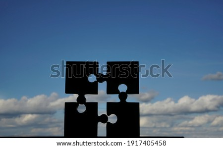 4 four  puzzle piece on blue cloudy sky  background. Jigsaw . 4 parts of whole. symbol of association and connection. business strategy. Foto d'archivio ©