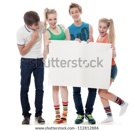 Four teenagers hold the form