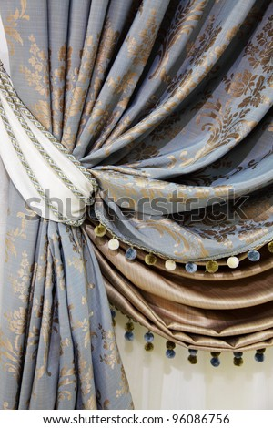 fragment of the beautiful curtains with fringe