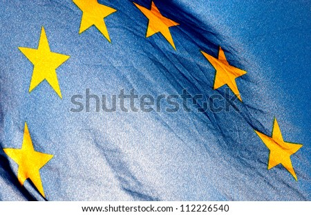 Fragment of the European Union Flag waving in in backlit sunlight