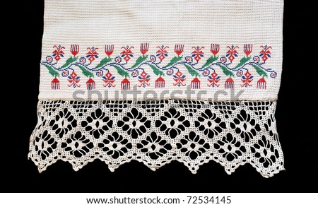 Fragment of the old embroidered towel