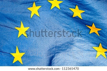 Fragment of the waving European Union Flag in sunshine