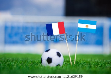 France and Argentina National flag - green grass and football ball. Round of 16. #1121639159