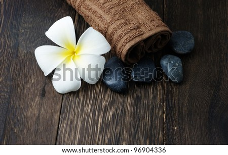 Frangipani flower with zen stones and towel for spa concept