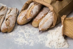 French baguettes on table with flour