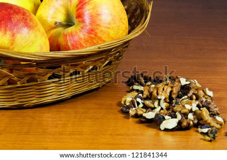Fresh apples and walnuts on a wooden table