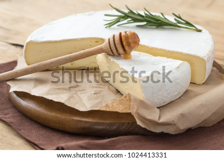 Fresh Brie cheese with herbs and honey