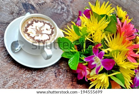 Fresh cup of coffee with flowers