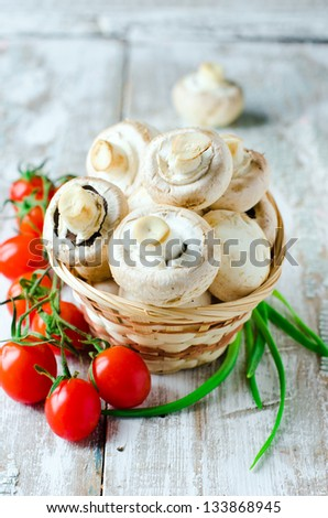 Fresh field mushrooms and tomatoes. Selective focus - stock photo