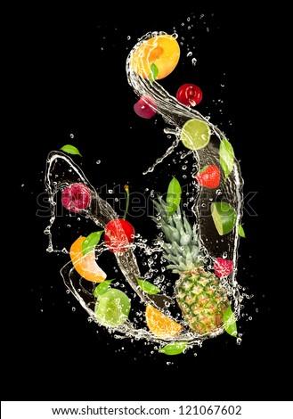Fresh fruits falling in water splash, isolated on black background