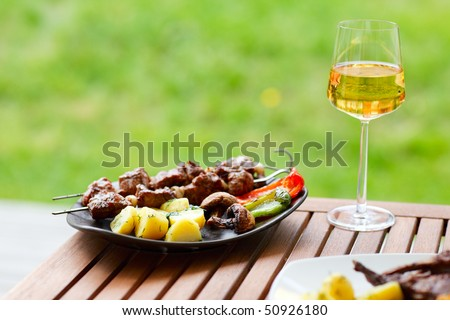 Fresh grilled meat and vegetables served outdoors