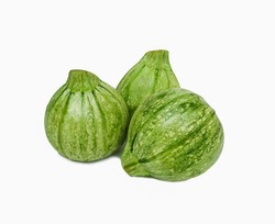 fresh round courgettes or zucchini on white background