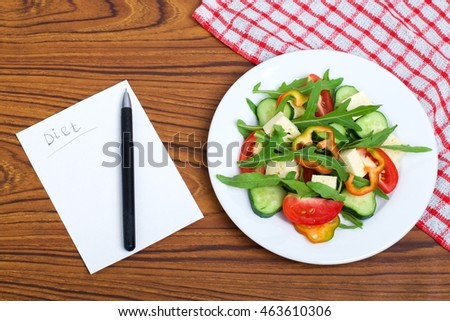 fresh vegetables salad and chees on wooden table. #463610306