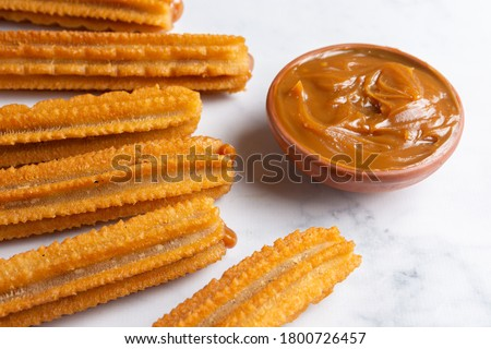 fried churros filled with dulce de leche Foto stock ©