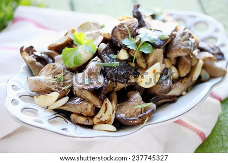 Fried mushrooms with garlic and fresh coriander