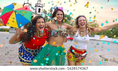 Friends in costume for the carnival on the streets of Olinda. Celebrating Carnival.