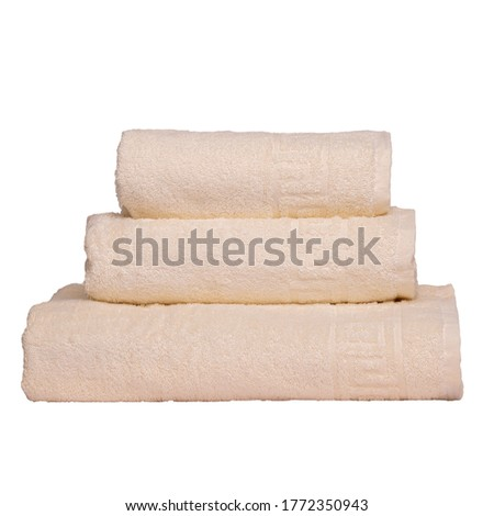 3 frotte towels beige color, bedroom towel white backgroung. Colorful beige bath towels isolated on white. Stack beige towels. Pile colored towels isolate. Three cotton towel of same color stacked.