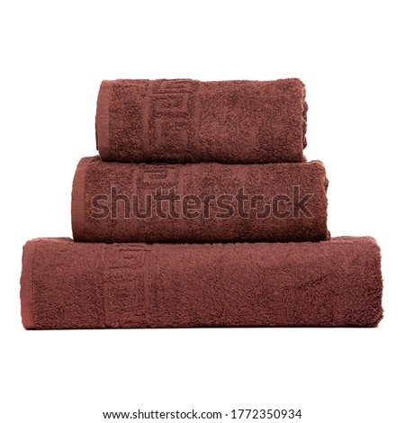 3 frotte towels brown color, bedroom towel white backgroung. Colorful brown bath towels isolated on white. Stack brown towels. Pile colored towels isolate. Three cotton towel of same color stacked.