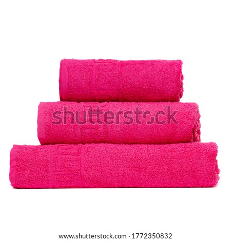 3 frotte towels crimson color, bedroom towel white backgroung. Colorful crimson bath towels isolated. Stack crimson towels. Pile colored towels isolate. Three cotton towel of same color stacked.