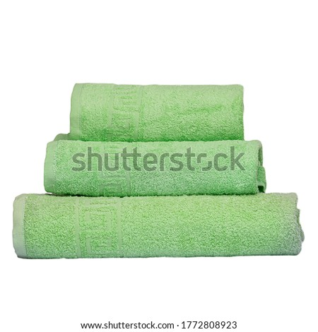 3 frotte towels green color, bedroom towel white backgroung. Colorful green bath towels isolated on white. Stack green towels. Pile colored towels isolate. Three cotton towel of same color stacked.
