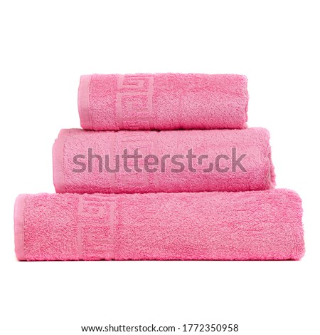 3 frotte towels pink carnation color, bedroom towel white backgroung. Colorful pink carnation color bath towels isolated on white. Stack pink carnation towels. Pile colored towels isolate stacked.
