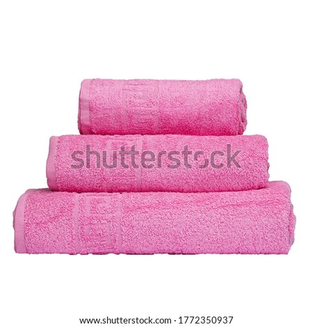 3 frotte towels pink color, bedroom towel white backgroung. Colorful pink bath towels isolated on white. Stack pink towels. Pile colored towels isolate. Three cotton pink towel of same color stacked.