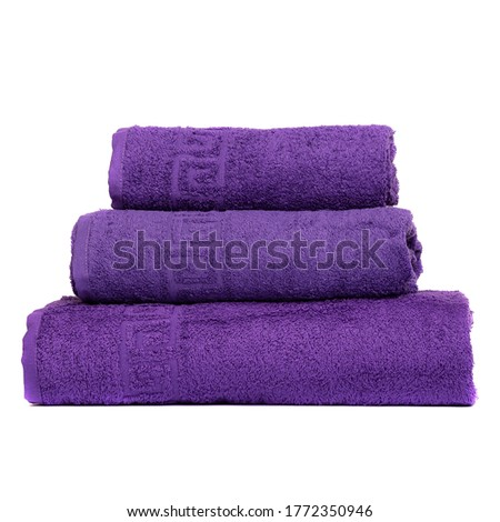 3 frotte towels purple color, bedroom towel white backgroung. Colorful violet bath towels isolated on white. Stack violettowels. Pile colored towels isolate. Three cotton towels of same color stacked.