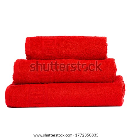 3 frotte towels Red color, bedroom towel on white backgroung. Colorful coral bath towels isolated on white. Stack red towels. Pile colored towels isolate. Three cotton towel of same color stacked.