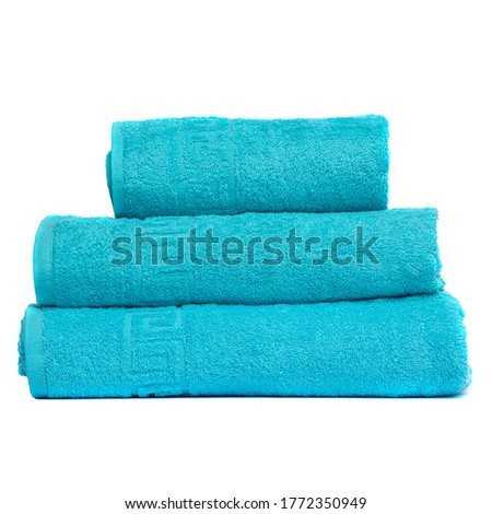 3 frotte towels turquoise color, bedroom towel white backgroung. Colorful turquoise bath towels isolated. Stack turquoise towels. Pile colored towel isolate. Three cotton towels of same color stacked
