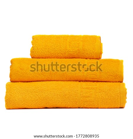 3 frotte towels yellow color, bedroom towel white backgroung. Colorful yellow bath towels isolated on white. Stack yellow towels. Pile colored towels isolate. Three cotton towel of same color stacked