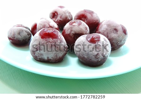 frozen berry cherries covered with hoarfrost