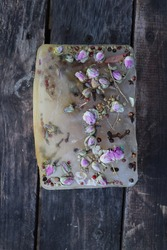 frozen flower on wooden background