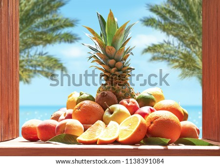 Fruit set of oranges, pineapple, apples, peaches, kiwi, lemons, lime, nectarines against the background of the sea. #1138391084