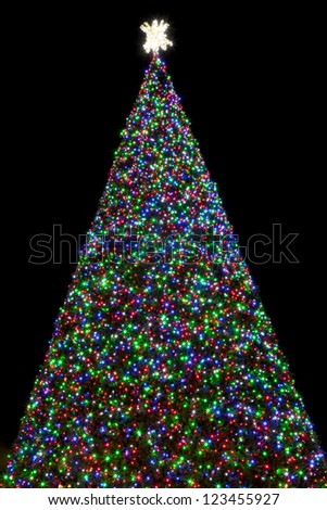 100 Ft Christmas Tree Covered With Red Green And Blue Lights At Night