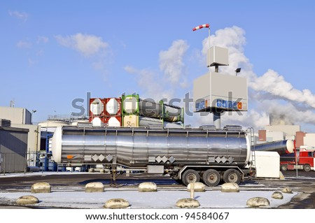 Fuel Tanker Truck in front of container warehouse