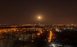 full moon over night city
